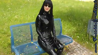 Fetish Lady Walking Outdoors In Chap-fallen Beaming Outfits