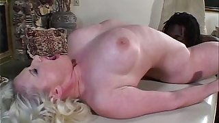hot milf with a young black male for some interracial sex