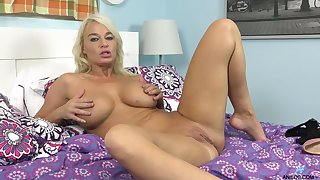 Naked whore plays with her juicy boobies and pets her wet pussy