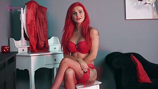 Sexually charged red haired woman Roxi K tells erotic stories in despondent lingerie