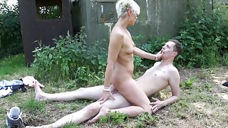 Naked mature rides young lad's cock then sucks rosiness dry