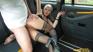 Tanya Gripe rubs her cunt in the taxi-cub then lets the driver turtle-dove her hard