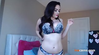 Horny sexy brunette gets ready to incrimination for striptease at near webcam.
